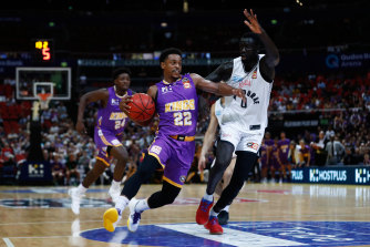 Casper Ware battles with Jo Lual Acuil during the third NBL semi-final match between the Sydney Kings and Melbourne United in March.
