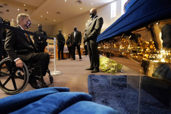 Texas Governor Greg Abbott, left, stops to pray by the casket of George Floyd in Houston, Texas, on Monday.