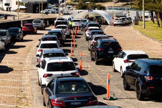 Drive-through COVID-19 testing was at full capacity at Bondi Beach on Monday morning.