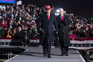 President Donald Trump and Vice President Mike Pence arrive for a campaign rally at Cherry Capital Airport in Michigan.