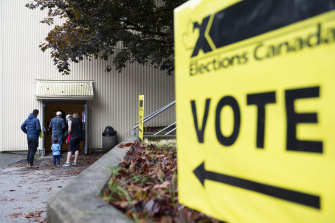 Voters arrive at a polling station in North Vancouver, British Columbia, Canada, on Monday.