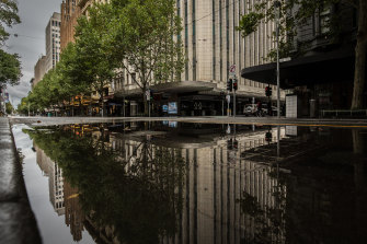 Swanston Street was wet - and empty - all weekend.