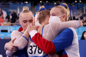 Team ROC (aka Russia) celebrates their gold medal win during the women's team gymnastics final.