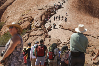 Visitors climbing up Uluru on Friday.
