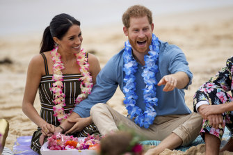 Meghan (pictured with Prince Harry at Bondi on their 2018 Australian tour) was a hit with the Australian public ... but trouble lay ahead.