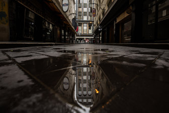 A morbid shade of itself - a deserted Degraves Street in the heart of Melbourne.