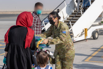People leaving Afghanistan for Australia last month in the wake of the Taliban takeover.