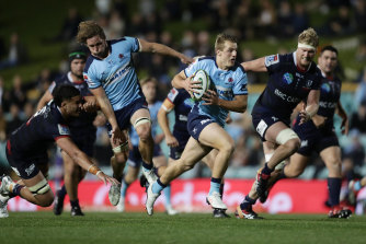 Joey Walton bags a try for the Waratahs.