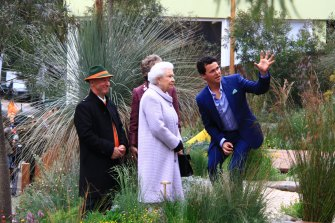 Phillip Johnson (right) and Wes Fleming take the Queen through their Chelsea Flower Show garden in 2013.