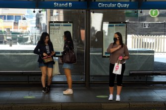 Passengers wait for a bus at Circular Quay on Monday.