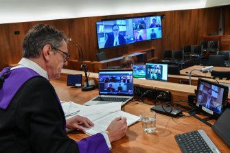 County Court judge Trevor Wraight at aplea hearing last month with lawyers and the accused appearing via videolink.