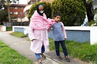 Maizen takes his grandmother for a walk around the block in Lakemba  during Sydney's lockdown.