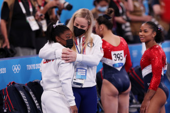 Simone Biles is comforted by coach Cecile Landi.