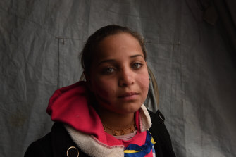Ten-year-old Sabeen, from Mosul at Qayyarah camp in northern Iraq in 2017. She was on her way to school when a car bomb killed her brother and injured her leaving scars on her face.