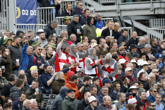 England's cricket fans cheer for their team during day three of the fourth Ashes Test.