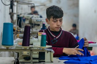 Ahmad works as a tailor in a small pyjama factory in Aleppo, Syria, from 8am to 8pm six days a week.