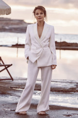 Sigrid wears suit by Max Mara.