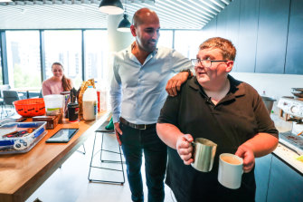 Happy at work: office barista Kane Cross, right, with his boss, VetTrak general manager Trevor Fairweather, and colleague Bridgette Kaminski.