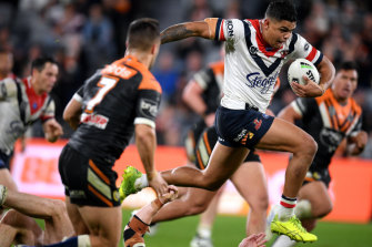 Stepping out: Latrell Mitchell was back to his bullocking best against the Tigers.
