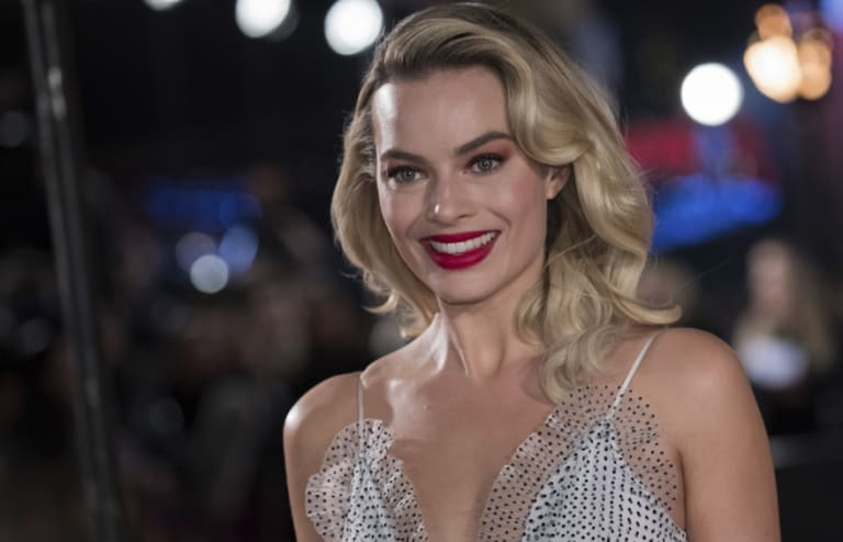 Margot Robbie poses for photographers upon arrival at the premiere of the film 'Mary Queen of Scots.