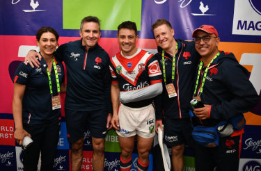 Winning team: Cronk with the Roosters medical staff after the grand final.