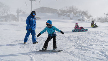 Kids learning how to snowboard as the first big snow of the season fell, 2018.