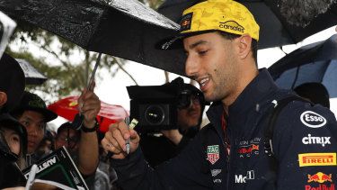 Daniel Ricciardo greets fans at Albert Park.