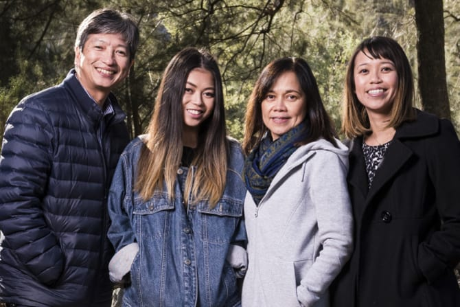 Kathleen Bautista (centre left) with her father Ronnie (left), mother Rowena (centre right), sister Megan (far right).