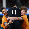 Jordan Petaia (left) and (right) Michael Hooper make a tackle in Saturday's first Bledisloe Cup match.