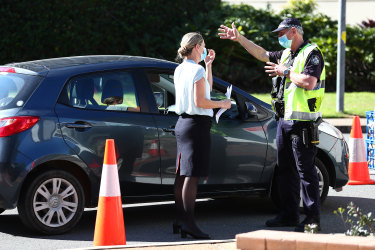 Queensland police stopping vehicles at a state border checkpoint in Coolangatta.