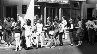 Fans of the Monkees wait outside the Sheraton Hotel in Kings Cross, Sydney, where the band was staying. One fan fainted from excitement, September 20, 1968.