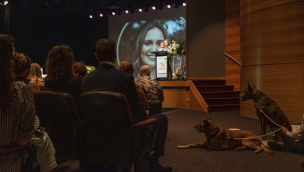 Family, friends and pets Frankie and Django watch on during the service on Monday.