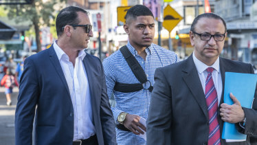 Manase Fainu (centre) arriving at Liverpool police station on October 29 with manager Mario Tartak (left) and legal representative Elias Tabchouri.