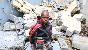 Abel Jeffery, 10, at the damaged Mendi School of Nursing, where 5 buildings were seriously damaged in the February earthquakes.