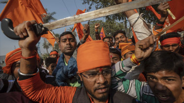 Hindu hardliners chant slogans against Muslim communities during a rally last November demanding a Hindu temple be built on the site of a 16th century mosque, destroyed in 1992.