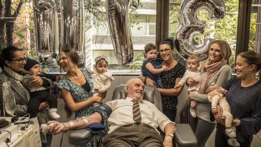 James Harrison, surrounded by mothers of Anti-D babies at his final donation.  (from left to right): Christine Damiandis and Georgio, Michelle Dibbs and Eloise, Tanya McLaren and Brianna, Sarah Doyle and Grace.