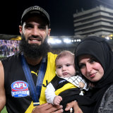 Bachar Houli after the 2020 grand final win with wife Rouba and son Mohamed.