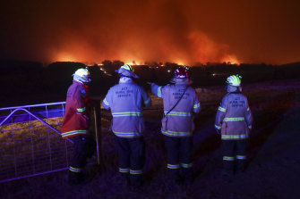 ACT Rural Fire Service members at a bushfire near Adaminaby. Labor backbencher Mike Kelly has raised concerns about the number of volunteers in fire services nationally.