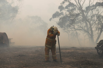 An RFS fire fighter on the North Black Range last November, with months more fires to come at that point.