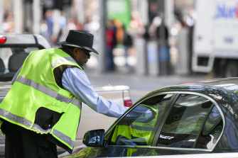 A Melbourne City Council ranger issues a parking ticket in 2016.