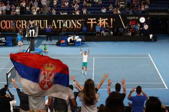 Novak Djokovic waves to the crowd after beating Aslan Karatsev.