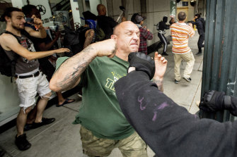 A man tussles with protesters against right-wing demonstrators in Portland on Saturday.