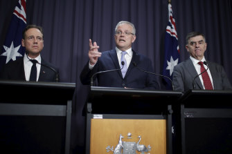 Health Minister Greg Hunt, Prime Minister Scott Morrison and Chief Medical Officer Professor Brendan Murphy on Thursday.