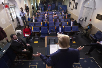 President Donald Trump speaks during a coronavirus task force briefing at the White House on Saturday, April 18.