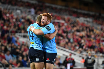 Bass of the scrum: Johnson-Holmes in action for the Waratahs.