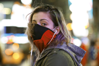 Brooklyn waitress Casey Stewart peers out from a ski mask she adapted to protect herself from coronavirus after riding the subway to Times Square.