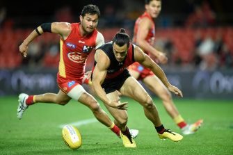 Dylan Shiel leads Jarrod Harbrow to the ball.