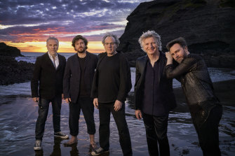 The new Crowded House line up on a New Zealand beach in March. From left, Nick Seymour, Elroy Finn, Mitchell Froom, Neil Finn, Liam Finn.