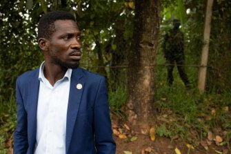 Ugandan security forces are seen outside Bobi Wine's property