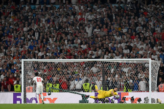 The crowd watches Italy save an English penalty in a shootout during the final of the UEFA Euro 2020 on July 11.